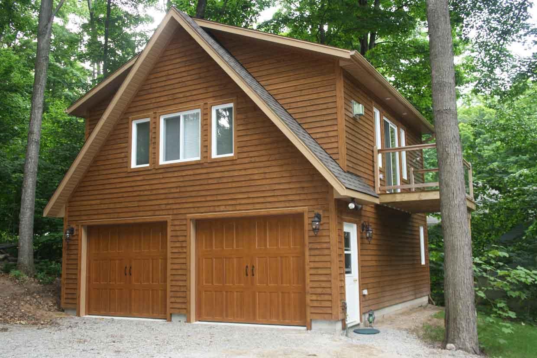 Custom garage with loft jvl homes for Custom home garage